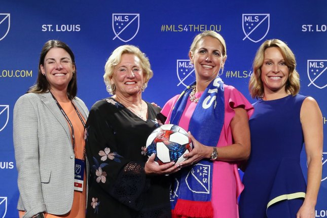 Four members of the new St. Louis Major League Soccer franchise ownership group from left to right, Patty Taylor, Jo Ann Taylor Kindle, Carolyn Kindle Betz, and Chrissy Taylor, pose for photos following ceremonies in St. Louis on Tuesday. Photo by Bill Greenblatt/UPI