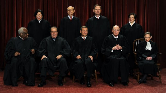 The Supreme Court Justices of the United States sit for a formal group photo in the East Conference Room of the Supreme Court in Washington. The Justices are (front row from left) Clarence Thomas, Antonin Scalia, John G. Roberts (Chief Justice), Anthony Kennedy, Ruth Bader Ginsburg; (back row from left) Sonia Sotomayor, Stephen Breyer, Sameul Alito and Elena Kagan, the newest member of the Court. UPI/Roger L. Wollenberg
