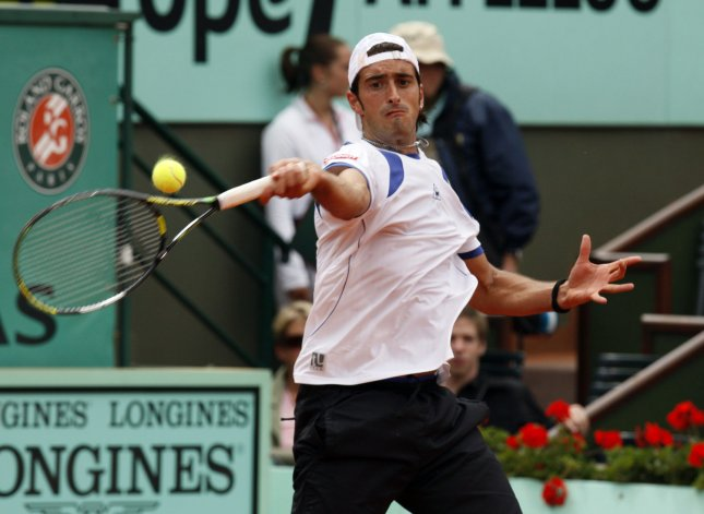 Potito Starace, shown playing in a 2007 tournament, claimed a first-round win Monday at the Warsaw Open.