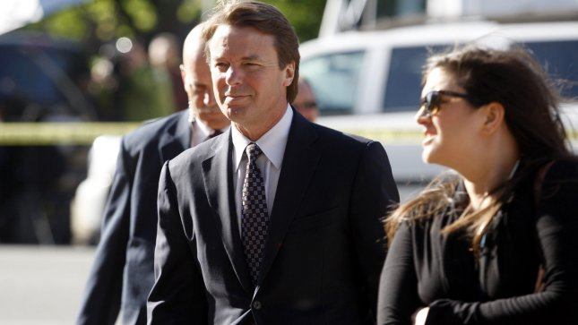 Former U.S. Senator and presidential candidate John Edwards arrives with his daughter Cate at the federal courthouse in Greensboro, North Carolina on April 24, 2012. UPI/Nell Redmond