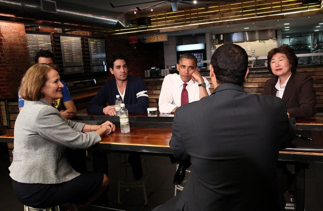 Affordable Care Act may help small business attract better employees. U.S. President Barack Obama meets with small business leaders at Taylor Gourmet, a sandwich restaurant, with Small Business Administrator Karen Mills (L), May 16, 2012 in Washington, DC. UPI/Win McNamee/Pool