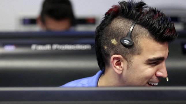 Activity lead Bobak Ferdowsi, who cuts his hair differently for each mission, works inside the Spaceflight Operations Facility for NASA's Mars Science Laboratory Curiosity rover at Jet Propulsion Laboratory (JPL) in Pasadena, California on August 5, 2012. The Curiosity robot is equipped with a nuclear-powered lab capable of vaporizing rocks and ingesting soil, measuring habitability, and potentially paving the way for human exploration, and was designed to assess whether Mars ever had an environment able to support small life forms called microbes. UPI/Brian van der Brug/pool