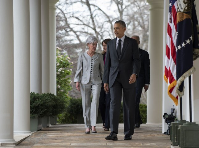 President Barack Obama leads Health and Human Services Secretary Kathleen Sebelius, HHS Secretary Nominee Sylvia Mathews Burwell and Vice President Joe Biden from the Oval Office along the West Colonnade to the Rose Garden at the White House in Washington, DC on April 11, 2014. Obama accepted Sebelius' resignation and nominated Burwell for HHS Secretary at the Rose Garden event. UPI/Pat Benic