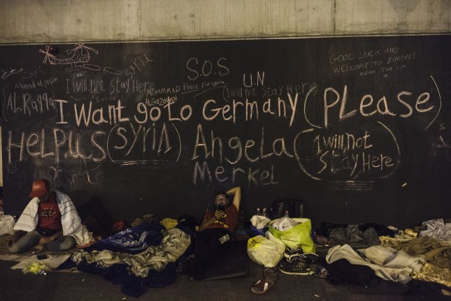 Migrants arrive at the central railway station in Munich on September 6, 2015. German Chancellor Angela Merkel announced a plan today to distribute refugees evenly throughout the European Union. File photo by David Silpa/UPI