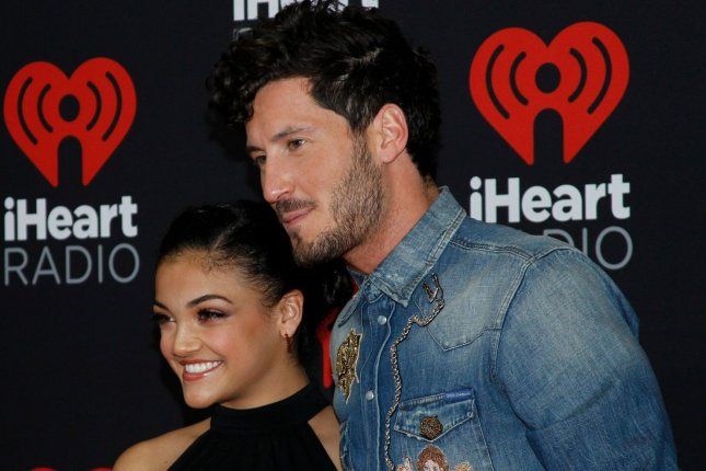 Olympic gymnast Laurie Hernandez and Val Chmerkovskiy -- partners on Dancing with the Stars -- arrive for the iHeartRadio Music Festival in Las Vegas on September 23, 2016. File Photo by James Atoa/UPI