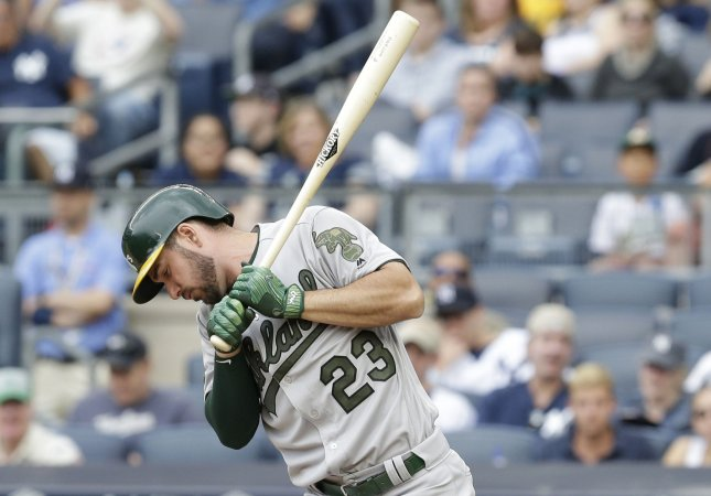 Matt Joyce of the Oakland Athletics reacts after a swing against the New York Yankees earlier this season. Photo by John Angelillo/UPI