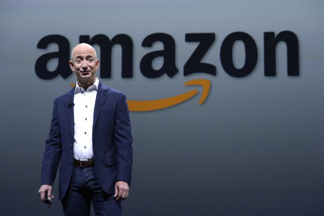 Amazon CEO Jeff Bezos is seen in a 2012 product unveiling. The online retail giant is experimenting with creating its own delivery service to speed the delivery of some third-party retailer products. File photo by Phil McCarten/UPI