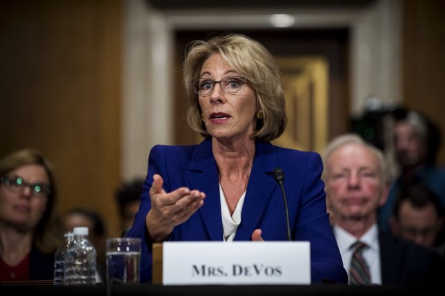 Civil rights groups sue Betsy DeVos over sexual assault policy
