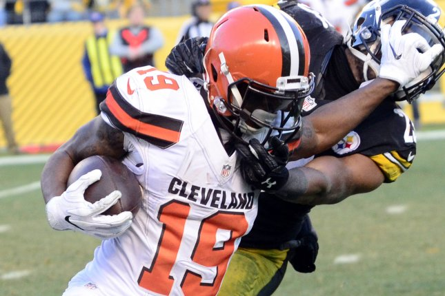 Pittsburgh Steelers free safety Mike Mitchell (23) receives a face mask penalty as he tackles former Cleveland Browns wide receiver Corey Coleman (19). File photo by Archie Carpenter/UPI