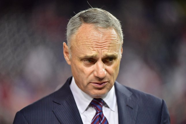 Major League Baseball commissioner Rob Manfred will implement a pitch clock during spring training games. File Photo by Kevin Dietsch/UPI