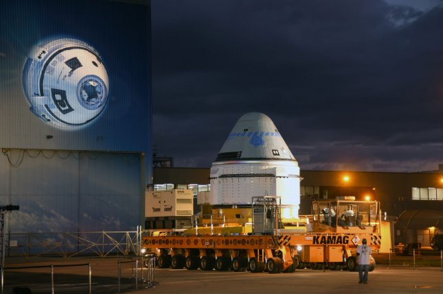 A Boeing Starliner spacecraft rolls out from the processing facility Thursday at the Kennedy Space Center in Florida. Photo by Joe Marino-Bill Cantrell/UPI
