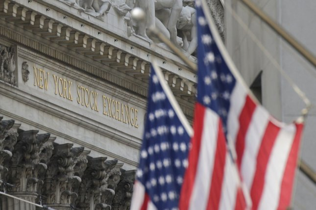 American Flags are seen outside the New York Stock Exchange on Wall Street in New York City on August 24. Photo by John Angelillo/UPI
