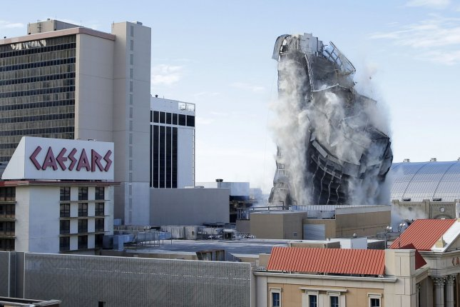 The Trump Plaza Hotel and Casino implodes to the ground during its demolition Tuesday in Atlantic City, N.J. The property closed in 2014 after years of bankruptcies and financial hardships for all establishments along the city's iconic Boardwalk. Photo by John Angelillo/UPI
