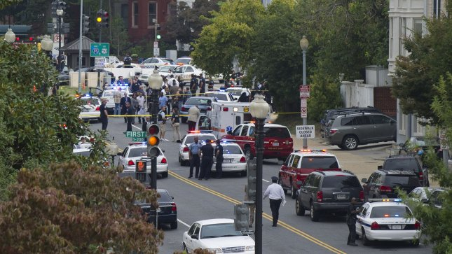 Capitol Hill Police respond to reports of gun shots fired outside of the Hart Senate Office Building near the U.S. Capitol Building in Washington, D.C. on October 3, 2013. UPI/Kevin Dietsch