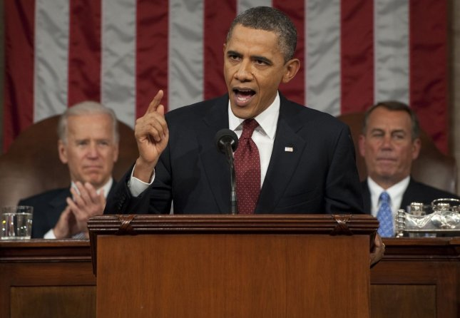 President Barack Obama delivered his State of the Union address last Tuesday, proposing a 30 percent minimum tax rate for those earning more than $1 million a year. Vice President Joe Biden (L) and Speaker John Boehner look on. UPI/Saul Loeb/Pool