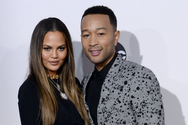 John Legend (R) and Chrissy Teigen at the American Music Awards on November 20. File Photo by Jim Ruymen/UPI