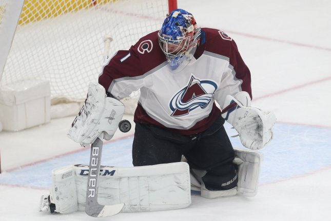Colorado Avalanche goaltender Semyon Varlamov of Russia makes a glove save against the St. Louis Blues in the first period on March 15 at the Scottrade Center in St. Louis, Mo. Photo by Bill Greenblatt/UPI