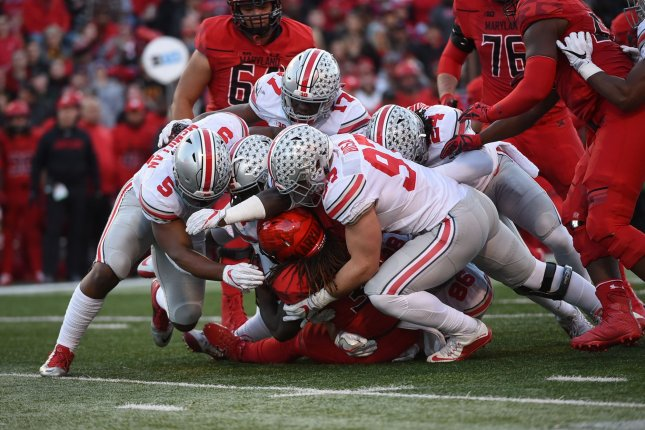 Ohio State Buckeyes linebacker Raekwon McMillan (5), linebacker Jerome Baker (17), safety Malik Hooker (24) and defensive end Nick Bosa (97) tackle Maryland Terrapins running back Kenneth Goins Jr. (30) during the first quarter of their game on November 12, 2016 in College Park, Maryland. File photo by Molly Riley/UPI