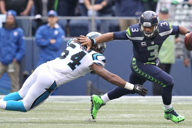 Seattle Seahawks quarterback Russell Wilson scrambles away from Carolina Panthers linebacker Shaq Thompson (54) at CenturyLink Field in Seattle, Wash. File photo by Jim Bryant/UPI