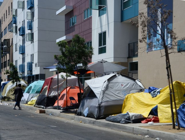Homeless encampments remain in the skid row section of Los Angeles on August 23, 2015. The poverty rate in California is the highest in the nation at 19 percent, according to data from the U.S. Census Bureau released Wednesday. Experts say the high cost of housing is to blame. File Photo by Jim Ruymen/UPI
