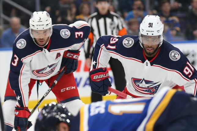 Columbus Blue Jackets teammates Seth Jones and Anthony Duclair wait for the drop of the puck against the St. Louis Blues in the first period on October 25 at the Enterprise Center in St. Louis. Photo by Bill Greenblatt/UPI
