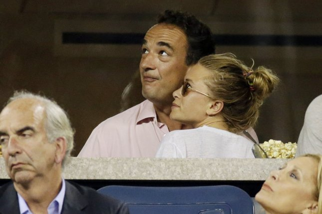 Mary-Kate Olsen (R) requested to file an emergency divorce petition following her split from Olivier Sarkozy. File Photo by UPI