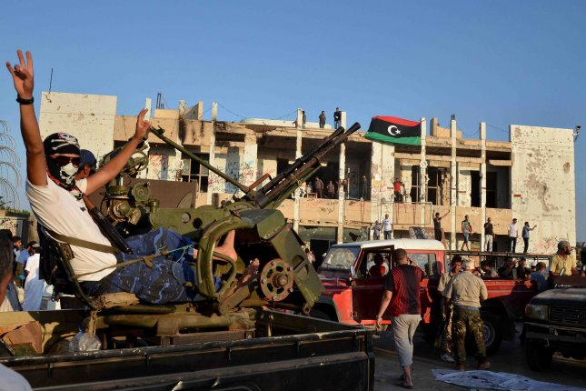Libyan Rebels celebrate as people tour the inside of Baba al Azizia, Moammar Gaddafi's main military compound on August 26, 2011 in Tripoli, Libya. The main compound has turned into a tourist attraction and a symbol of Gaddafi's ousted regime. Numbers of Libyans are gathering to celebrate his downfall and to tour the compound which up until August 23, 2011 has been hidden from public view until the recent surge into Tripoli by rebel forces. UPI/Tarek Faramawi