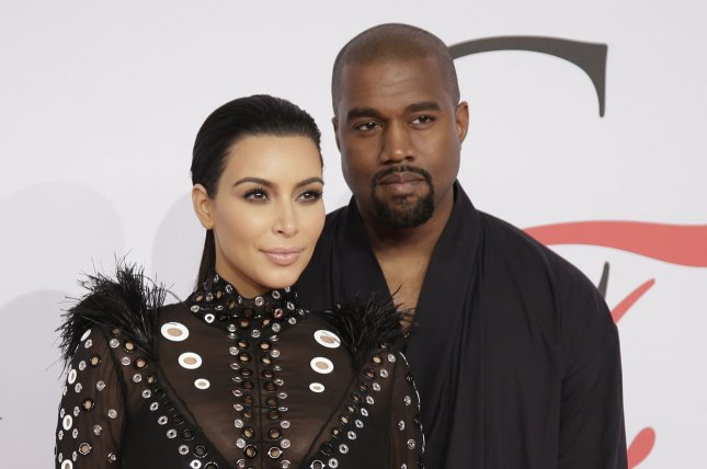 Kim Kardashian West and Kanye West arrive on the red carpet at the 2015 CFDA Fashion Awards at Alice Tully Hall at Lincoln Center in New York City on June 1, 2015. File Photo by John Angelillo/UPI