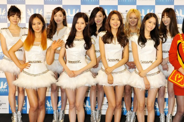 Girls' Generation attends a press conference in Saitama Prefecture, Japan, on March 2, 2014. The K-pop group celebrated Wednesday after their album Holiday Night topped the Billboard World Albums chart. File Photo by Keizo Mori/UPI