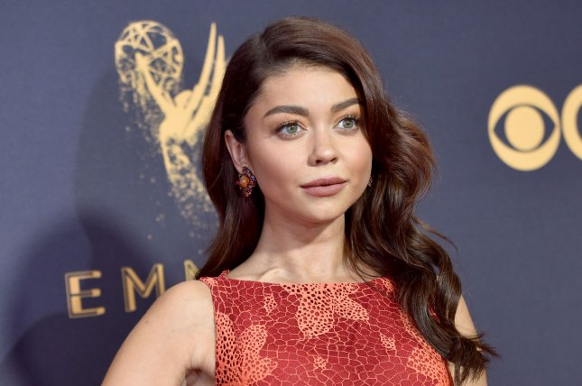 Sarah Hyland showed her affection for Wells Adams by sporting the Bachelorette alum's first initial around her neck. File Photo by Christine Chew/UPI