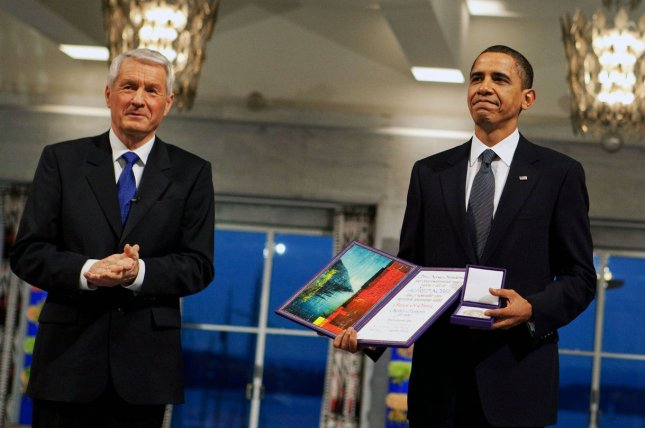Nobel Committee Chairman Thorbjorn Jagland (L) presents U.S. President Barack Obama with the Nobel Peace Prize medal and diploma during the Nobel Peace Prize ceremony in Raadhuset Main Hall at Oslo City Hall on December 10, 2009. File Photo by Pete Souza/The White House