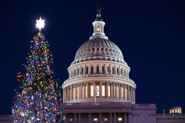 The 2020 U.S. Capitol Christmas Tree is lit on Wednesday night at the official lighting ceremony, on the grounds of the U.S. Capitol in Washington, D.C. Photo by Kevin Dietsch/UPI