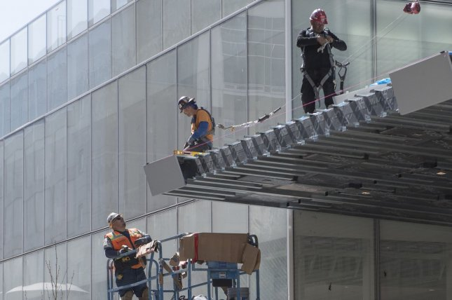 A construction crew is pictured working in San Francisco, Calif., on April 3, 2020. According to Wednesday's report, the private construction sector lost about 3,000 jobs during the month of February. File Photo by Terry Schmitt/UPI