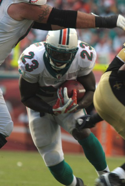 Miami Dolphins running back Ronnie Brown (23) runs through the New Orleans defense in first quarter action against the New Orleans Saints at Landshark Stadium. The Orleans Saints beat the Miami Dolphins 46-34 in Miami on October25, 2009. . UPI/Susan Knowles...