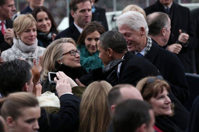 U.S. President Barack Obama greets Secretary of State Hillary Clinton and former president Bill Clinton during the presidential inauguration on the West Front of the U.S. Capitol January 21, 2013 in Washington, DC. Barack Obama was re-elected for a second term as President of the United States. UPI/Win McNamee/POOL