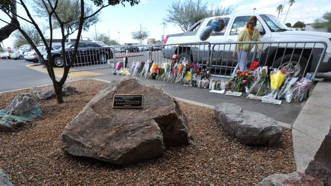 The boulders in the foreground form the memorial honoring the victims and survivors of the shootings one year a ago on January 8, 2011 that killed six and wounded thirteen in Tucson, Arizona, January 8, 2012. UPI /Art Foxall
