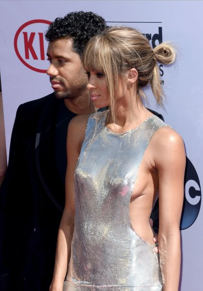 Singer and host Ciara (R) and her fiance Russell Wilson attend the annual Billboard Music Awards on May 22, 2016. Ciara posted an impromptu jam sesson of her with Wilson and a former teammate singing a capella. File Photo by Jim Ruymen/UPI