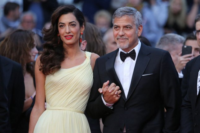 George and Amal Clooney spotted with twins for the first time