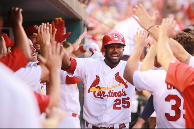 St. Louis Cardinals Dexter Fowler is congratulated in the dugout by teammates after hitting a solo home run in the fourth inning against the New York Mets at Busch Stadum in St. Louis on July 7, 2017. Photo by Bill Greenblatt/UPI