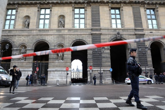 Security forces keep watch in front of the Louvre Museum in Paris, France, on February 3 which was closed following a terror attack. On Thursday, a group of Chinese tourists was robbed by assailants armed with tear gas, according to local reports. File Photo by Maya Vidon-White/UPI