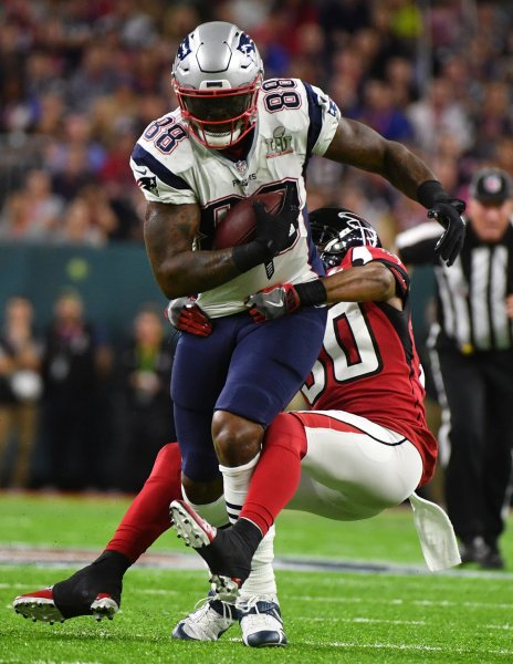 New England Patriots tight end Martellus Bennett takes off after catching a pass during Super Bowl LI against the Atlanta Falcons in February 2017. Photo by Kevin Dietsch/UPI