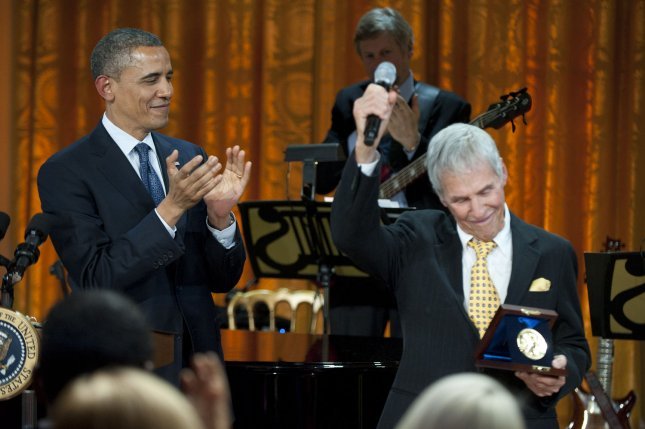 President Barack Obama applauds after awarding the Gershwin Prize to composer Burt Bacharach at a concert honoring Bacharach and fellow prize winner Hal David, in the East Room at the White House in Washington, May 9, 2012. UPI/Kevin Dietsch