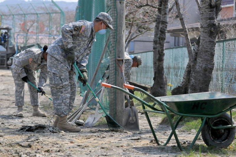 U.S. Army personnel remove sludge and rubble to clear an area around Minato elementary school in Ishinomaki, Miyagi prefecture, Japan, April 14, 2011. The area is recovering from an earthquake and tsunami in March. UPI/Keizo Mori