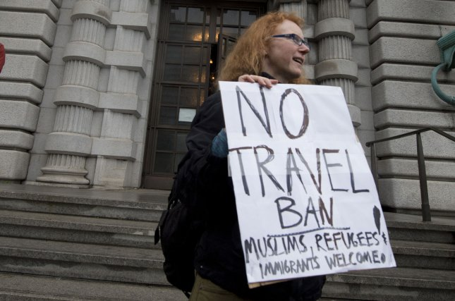 Justice Department to ask Supreme Court to review blocking Trump's travel ban