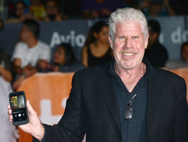 Ron Perlman films the event on his cellphone as he arrives at the world premiere of Stonewall during the Toronto International Film Festival on September 18, 2015. Perlman had dinner this week with David Harbour, the actor taking over his role in the next Hellboy movie. File Photo by Christine Chew/UPI