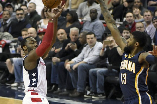 Washington Wizards guard John Wall (2) scores against Indiana Pacers forward Paul George (13) in the first half at the Verizon Center in Washington, D.C. on February 10, 2017. Photo by Mark Goldman/UPI