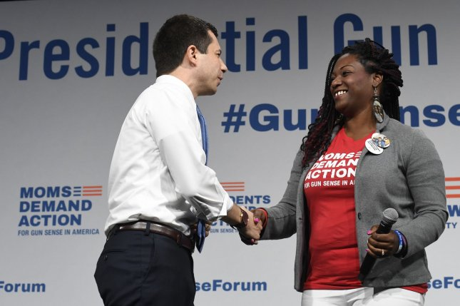 Democratic presidential candidate Pete Buttigieg greets DeAndra Dycus, a mother who lost a son to gun violence, at an August 10 gun safety forum in Des Moines, Iowa. File Photo by Mike Theiler/UPI