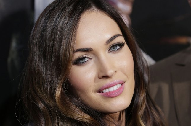 Megan Fox and Machine Gun Kelly were spotted holding hands and kissing following the actress' split from Brian Austin Green. File Photo by John Angelillo/UPI