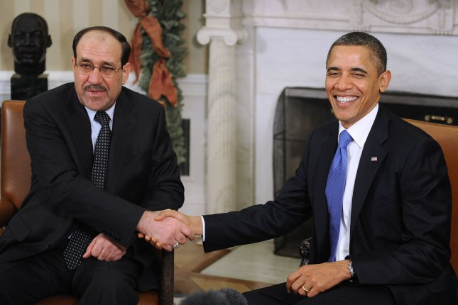 President Barack Obama meets with Iraqi Prime Minister Nouri al-Maliki in the Oval Office at the White House in Washington on December 12, 2011. UPI/Olivier Douliery/Pool