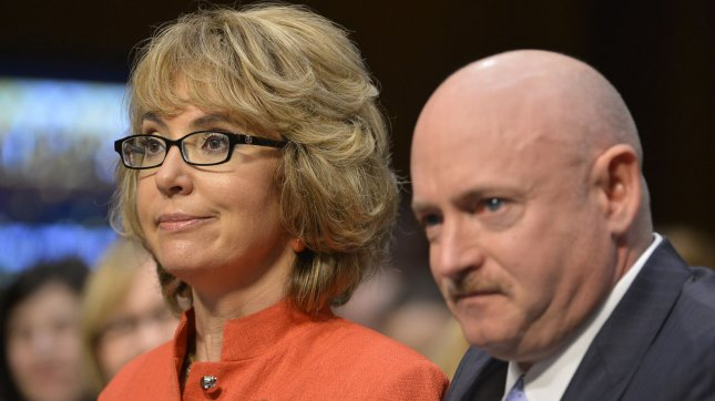 Former Arizona Congresswoman Gabrielle Giffords (L) makes opening remarks as she is helped by husband Capt. Mark Kelly, USN (Ret.) at the start of the Senate Judiciary Committee hearing on *What Should America Do About Gun Violence?*, on Capitol Hill, January 30, 2013, in Washington, DC. The panel is Congress's first major hearing on gun control in the wake of the Sandy Hook School shootings. UPI/Mike Theiler